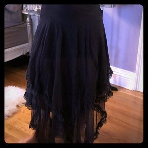 Black frilly free people skirt